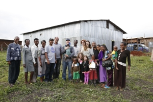 Aaron Blank, president/CEO of The Fearey Group, with his family and the leaders of our CarePoint site in Woliso, Ethiopia.