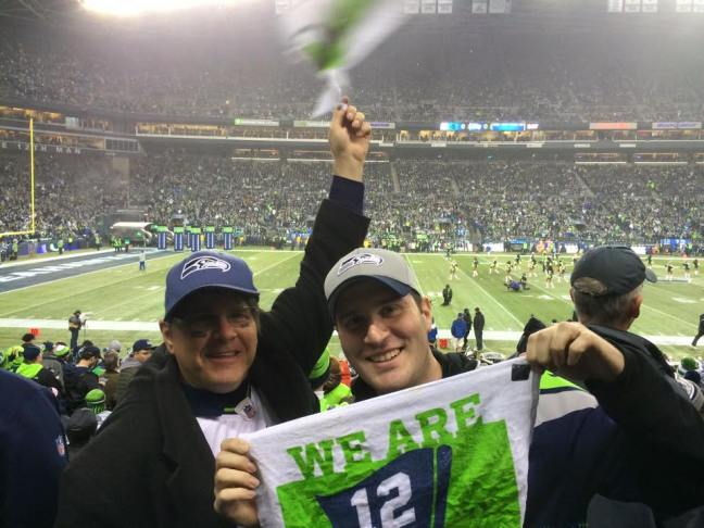 Aaron Blank with Alan Chitlik, owner of Puget Sound DJ at the 2014/15 NFC Divisional Game against the Carolina Panthers.